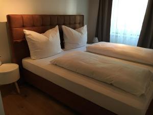 Ein Bett oder Betten in einem Zimmer der Unterkunft Apartment Enzinger