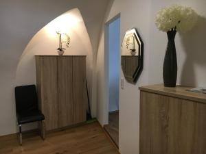 Ein Sitzbereich in der Unterkunft Apartment Enzinger