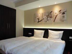 Een bed of bedden in een kamer bij Hotel Empire