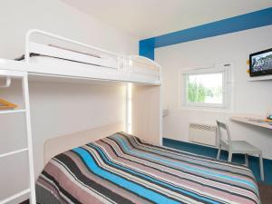 Un ou plusieurs lits superposés dans un hébergement de l'établissement hotelF1 Valenciennes Douchy les Mines