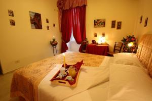Letto o letti in una camera di Bed Breakfast And Cappuccino