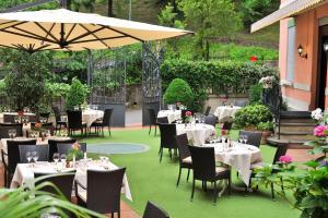 Ein Restaurant oder anderes Speiselokal in der Unterkunft Hotel Federale