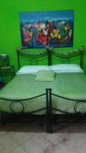A bed or beds in a room at Miriam un Arcobaleno