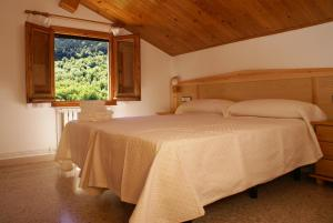 A bed or beds in a room at Casa Masover