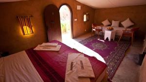 Un ou plusieurs lits dans un hébergement de l'établissement HOTEL Bab Rimal