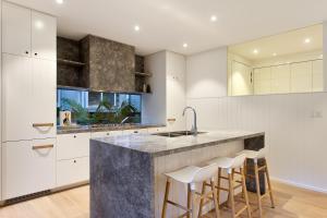 A kitchen or kitchenette at Luxury rainforest retreat, Little Cove