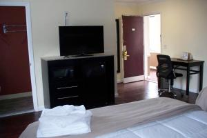 A television and/or entertainment center at Budget Inn & Suites