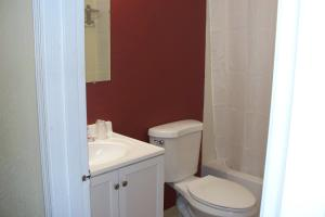 A bathroom at Budget Inn & Suites