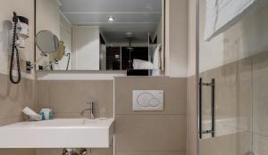 Ein Badezimmer in der Unterkunft Continental Hotel Lausanne