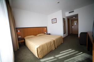 Uma cama ou camas num quarto em Hotel Bagoeira