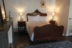 A bed or beds in a room at No 26 Minimum 3 nights