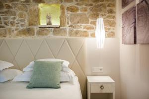 A bed or beds in a room at Balatura Split Luxury Rooms