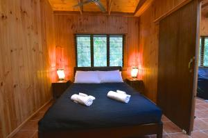 A bed or beds in a room at Daintree Cascades