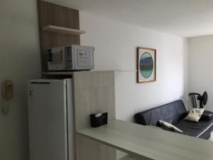A kitchen or kitchenette at Apartamento Tambaú