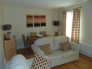 The lounge or bar area at Rathmullan Village Apartments