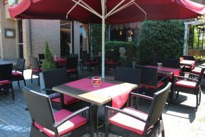 Ein Restaurant oder anderes Speiselokal in der Unterkunft Akzent Hotel Borchers