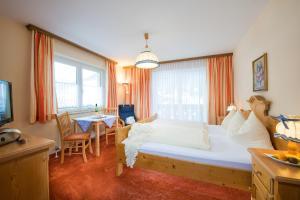 Ein Zimmer in der Unterkunft Pension St.Leonhard