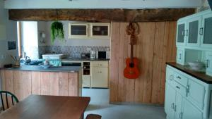 A kitchen or kitchenette at Gîte des Gabelous
