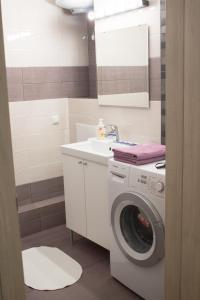 Ванная комната в Apartment Izumrudnyy Bereg