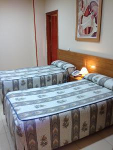 Cama o camas de una habitación en Hostal Aeropuerto