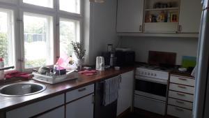 A kitchen or kitchenette at bedandshower
