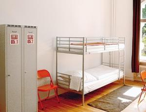 A bunk bed or bunk beds in a room at Gay Youth Hostel