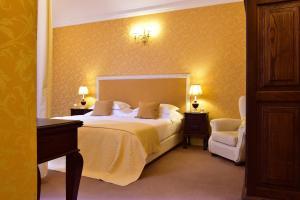 Un ou plusieurs lits dans un hébergement de l'établissement Pousada Convento de Evora
