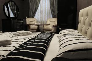 Cama o camas de una habitación en Egoiste Mini-Hotel