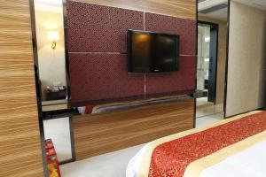 A television and/or entertainment center at Milu Hotel