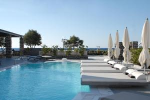 The swimming pool at or near Aqua Blue Beach Hotel