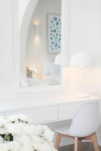 A bathroom at Aqua Blue Beach Hotel
