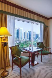 A seating area at Corniche Hotel Abu Dhabi