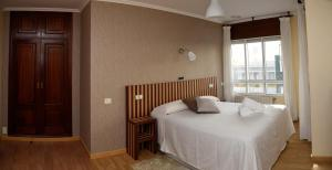 Cama o camas de una habitación en Hotel Villa De Ribadeo