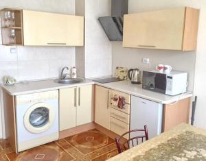 A kitchen or kitchenette at Apartment with Sea View near Park Shevchenko