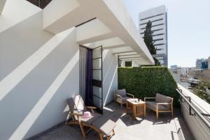 A porch or other outdoor area at Lily & Bloom Boutique Hotel