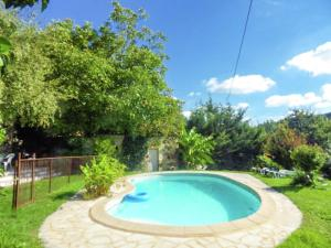 The swimming pool at or near Quaint Holiday Home in Grives with Swimming Pool