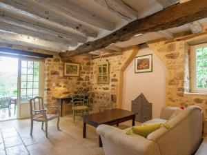 The lounge or bar area at Quaint Holiday Home in Grives with Swimming Pool