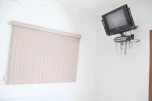 A television and/or entertainment center at Hotel Borges