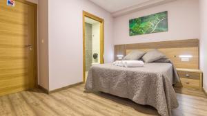 Cama o camas de una habitación en Pensión Pereiro