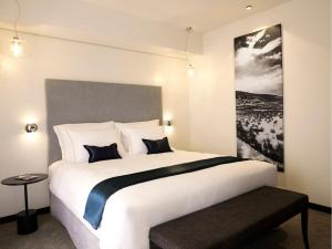A bed or beds in a room at Mind Hotel Slovenija - Terme & Wellness LifeClass