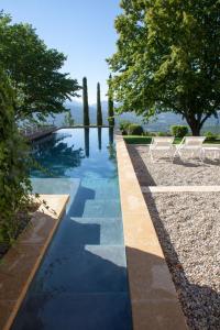 The swimming pool at or near Mas de L'Adret