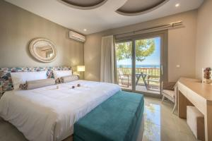A room at Koukounaria Hotel & Suites