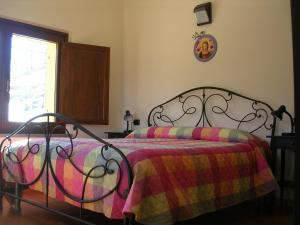 A bed or beds in a room at Agriturismo Il Faggio