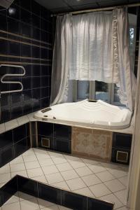 Un baño de Egoiste Mini-Hotel