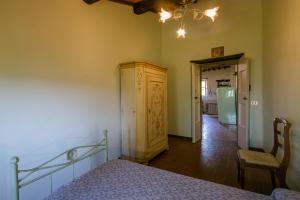 Letto o letti in una camera di Borgo Al Teto Il Gelso