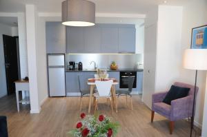 Una cocina o zona de cocina en Lisbonne Appartements
