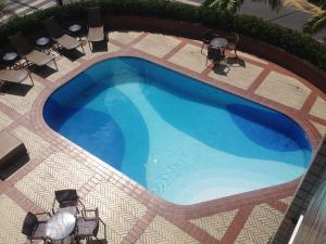 The swimming pool at or near Hotel Diogo