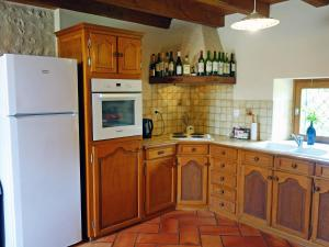 A kitchen or kitchenette at Holiday Home La Maison Monceny