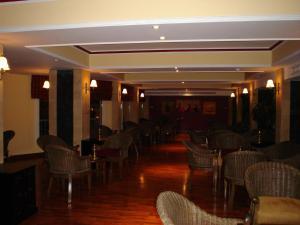 مطعم أو مكان آخر لتناول الطعام في فندق سى جاردن