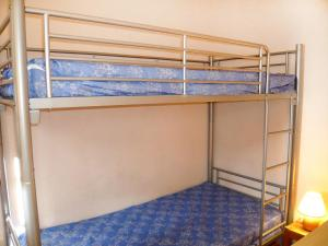 A bunk bed or bunk beds in a room at Holiday Home Les Amandines-3